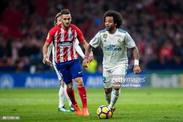 Marcelo Vieira Da Silva of Real Madrid is tackled by Jorge Resurreccion Merodio Koke of Atletico de Madrid during the La Liga 201718 match between...