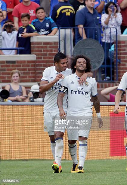 Marcelo Vieira Da Silva of Real Madrid right celebrates with Casemiro of Real Madrid after scoring his second goal against Chelsea during the first...