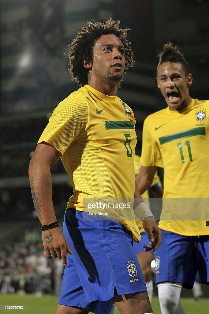 Marcelo Vieira (L) of Brasil celebrates a scored goal during a match against Mexico as part a friendly match between Mexico National Team and Brasil National Team at the Corona stadium on October 11, 2011 in Torreon, Mexico.