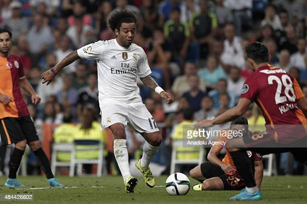 Marcelo Vieira of Real Madrid competes for the ball with Koray Gunter and Sabri Sarioglu of Galatasaray during the Santiago Bernabeu Trophy match...