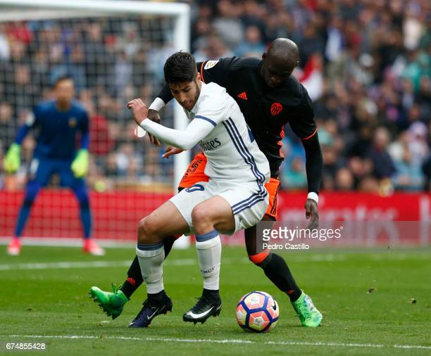 Marcelo Vieira of Real Madrid duels for the ball with Eliaquim Mangala of Valencia CF during the La Liga match between Real Madrid and Valencia CF at...