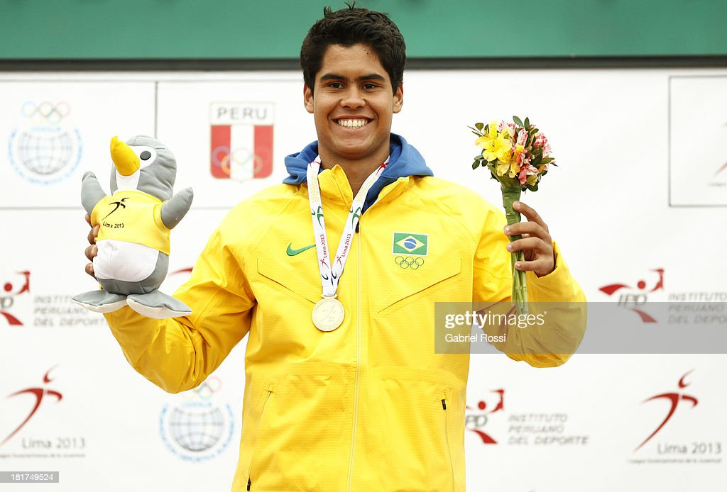 Marcelo Zormann of Brazil poses with his gold medal after the Final match as part of the I ODESUR South American Youth Games at Club Lawn Tenis de la Exposici?n on September 24, 2013 in Lima, Peru.
