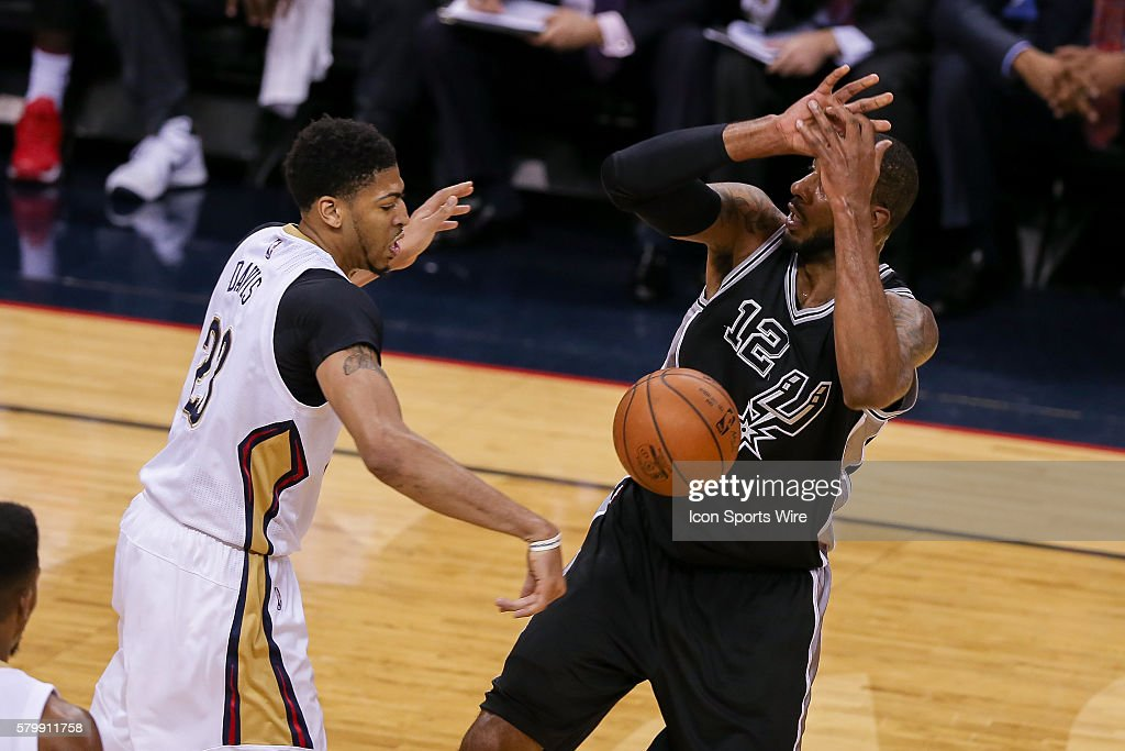 San Antonio Spurs forward LaMarcus Aldridge (12) has the ball stripped by New Orleans Pelicans forward Anthony Davis (23) during the NBA game between the San Antonio Spurs and the New Orleans Pelicans at the Smoothie King Center in New Orleans, LA.
