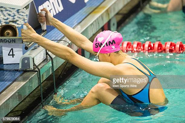 Andrea Berrino competes in the 100m backstroke consolation final during the Arena Pro Swim Series at the YMCA Aquatic Center in Orlando FL