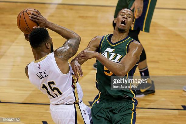 New Orleans Pelicans forward Alonzo Gee fouls Utah Jazz guard Rodney Hood during the NBA game between the Utah Jazz and the New Orleans Pelicans at...