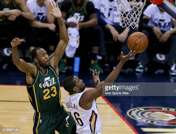 New Orleans Pelicans guard Toney Douglas drives to the basket against Utah Jazz forward Chris Johnson during the NBA game between the Utah Jazz and...