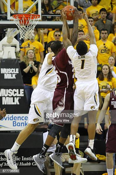 Mississippi State Bulldogs forward Roquez Johnson grabs a rebound over Missouri Tigers forward Keanau Post and guard Wes Clark during the NCAA men's...