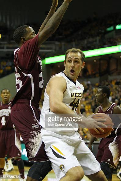Mississippi State Bulldogs forward Roquez Johnson guards Missouri Tigers forward Ryan Rosburg during the NCAA men's basketball game between the...