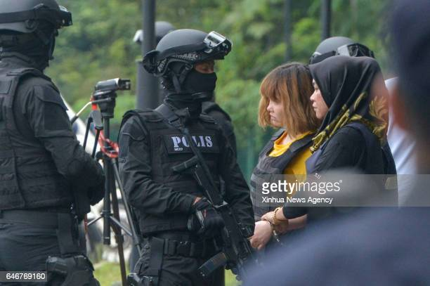 SEPANG March 1 2017 Vietnamese national Doan Thi Huong leaves the Sepang court as she is escorted with Malaysia special armed forces in Sepang...