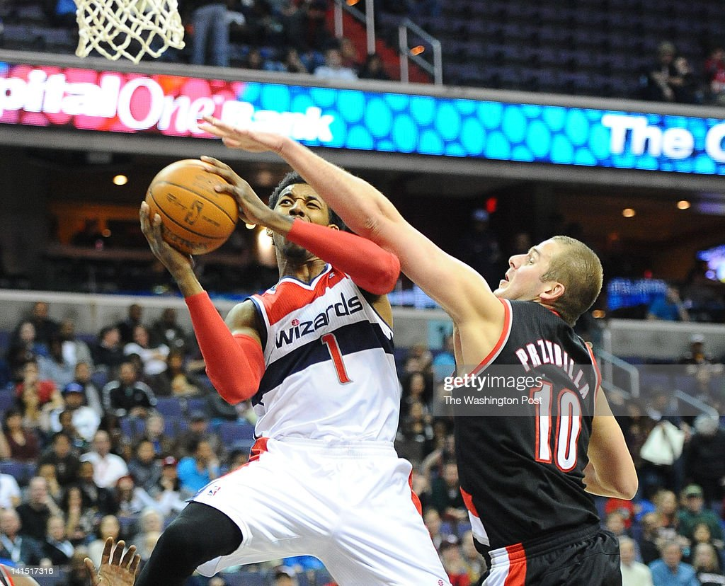 Washington Wizards shooting guard Nick Young (1) is fouled by Portland Trail Blazers center Joel Przybilla (10) as he goes to the basket during 1st half action on March 10, 2012 in Washington, DC