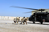 March 12, 2009 - Soldiers rush a simulated casualty to a UH-60 Blackhawk helicopter during an air assault and medical evacuation training on Camp Echo, Iraq. The soldiers train constantly to maintain their combat readiness.