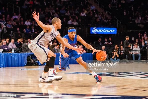 DePaul Blue Demons guard Brandon Young losses the ball as Georgetown Hoyas guard Markel Starks defends during the first round of the BigEast...