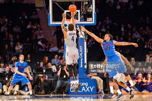 Georgetown Hoyas guard D'Vauntes SmithRivera shoots past DePaul Blue Demons forward Jamee Crockett during the first round of the BigEast basketball...