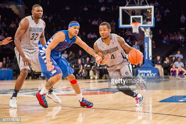 Georgetown Hoyas guard D'Vauntes SmithRivera works the ball past DePaul Blue Demons guard Brandon Young during the first round of the BigEast...