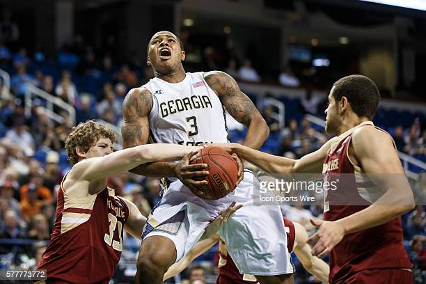 Georgia Tech Yellow Jackets forward Marcus GeorgesHunt is fouled by Boston College Eagles guard Patrick Heckmann and forward Ryan Anderson during the...
