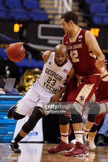 Georgia Tech Yellow Jackets guard Trae Golden tries to get past Boston College Eagles forward Ryan Anderson during the ACC 2014 basketball tournament...