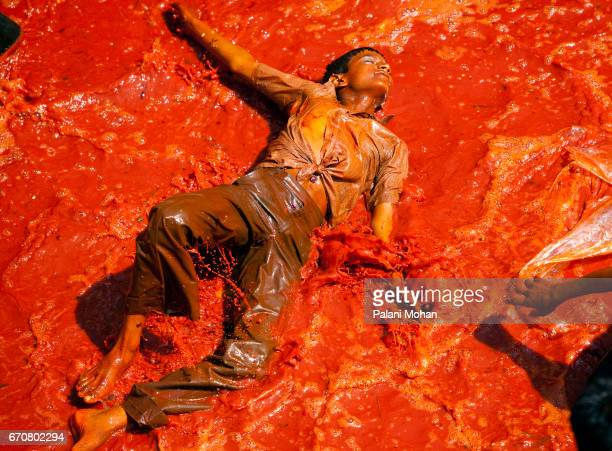 A young Indian boys play with coloured water as tens of thousands of Indian celebrate Holi the festival of colours at a temple on March 12 2008 in...