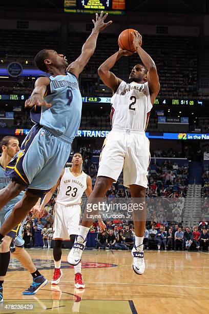 Darius Miller of the New Orleans Pelicans takes a shot against the Memphis Grizzlies during an NBA game on March 12 2014 at the Smoothie King Center...