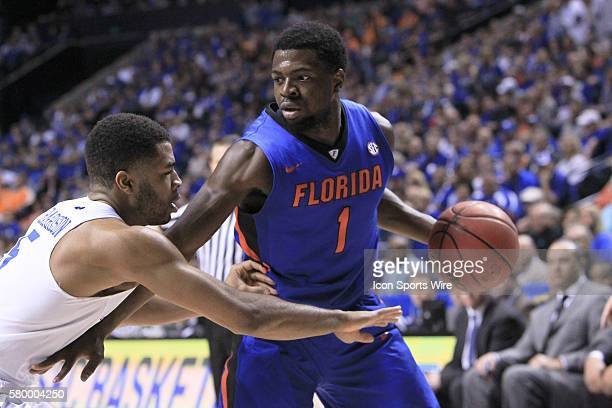 Florida Gators guard Eli Carter holds off Kentucky Wildcats guard Andrew Harrison during the Kentucky Wildcats versus the Florida Gators in the 2015...