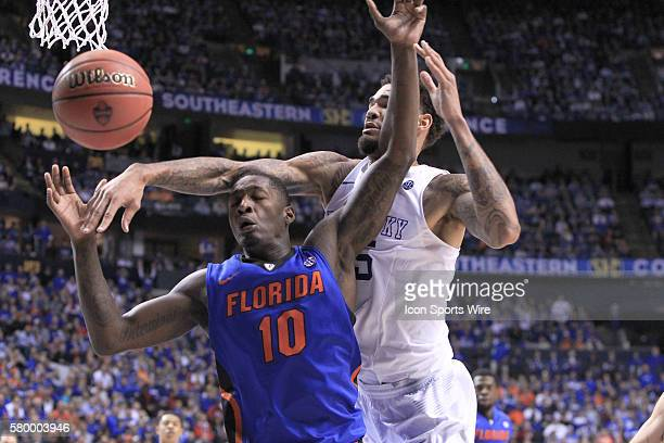 Kentucky Wildcats guard Andrew Harrison denies Florida Gators forward Dorian FinneySmith a rebound during the Kentucky Wildcats versus the Florida...