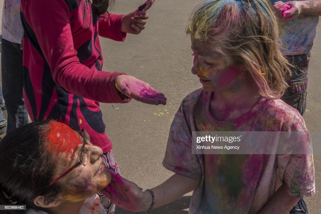 NEW DELHI, March 13, 2017 -- People play with colored powder during the celebration of Holi in New Delhi, India on March 13, 2017. India Monday celebrated Holi, the Hindu festival of colors which comes at the end of the winter season and marks the beginning of spring.