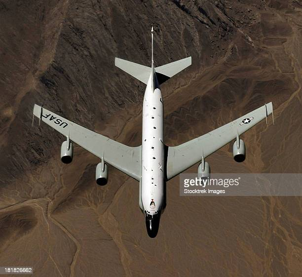 March 14, 2006 - A U.S. Air Force RC-135 Rivet Joint reconnaissance aircraft prepares for an aerial refueling over Kyrgyzstan.