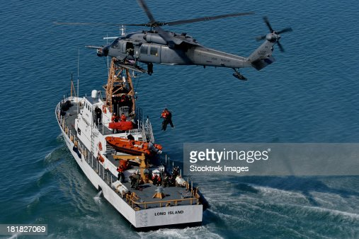 March 14, 2012 - An Alaska Air National Guard HH-60G Pave Hawk performs a hoist over U.S. Coast Guard Cutter Long Island.