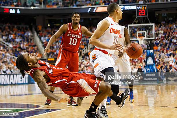 North Carolina State Wolfpack guard Anthony Barber draws the offensive foul on Syracuse Orange guard Tyler Ennis during the ACC 2014 basketball...