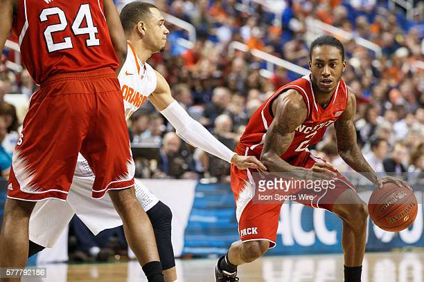 North Carolina State Wolfpack guard Anthony Barber dribbles the ball around the pick set by forward TJ Warren on Syracuse Orange guard Tyler Ennis...