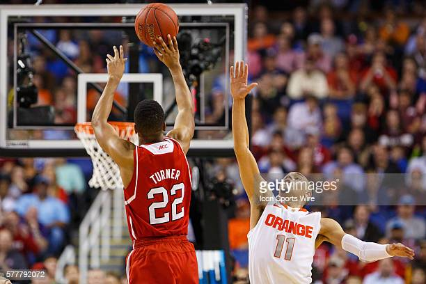 North Carolina State Wolfpack guard Ralston Turner shoots the three point shot over Syracuse Orange guard Tyler Ennis during the ACC 2014 basketball...