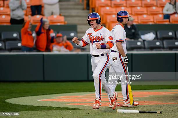Clemson Tigers catcher Chris Okey scores the tying run in the sixth inning during Game 2 of a doubleheader between Notre Dame and Clemson at Doug...