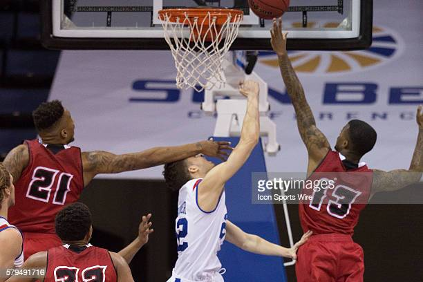 March 14 2015 Georgia State Panthers guard RJ Hunter misses a lay up defended by Louisiana Lafayette Ragin Cajuns guard Hayward Register during the...