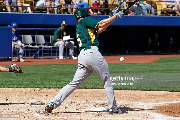 Luke Carlin of the A's tips the ball foul during Big League Weekend featuring the Chicago Cubs versus the Oakland A's at Cashman Field in Las Vegas NV