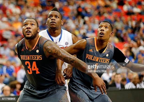 Jeronne Maymon and Josh Richardson of Tennessee and Will Yeguete of Florida watch the free throw during the SEC Basketball Tournament semifinal match...