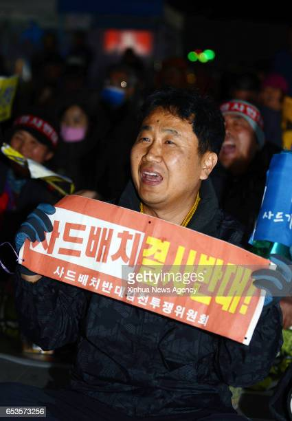 GIMCHEON March 15 2017 A protestor holding an antiTHAAD banner participates in a candlelit rally in Gimcheon North Gyeongsang province South Korea...