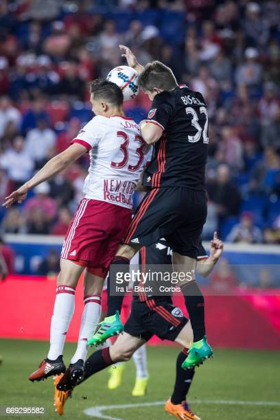 New York Red Bulls Defender Aaron Long and DC United Defender Bobby Boswell go up for the ball and control during the Soccer MLS New York Red Bulls...