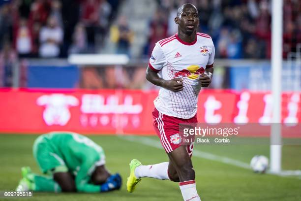 New York Red Bulls Forward Bradley WrightPhillips begins to celebrate with DC United goalkeeper Bill Hamid on the ground in frustration during the...