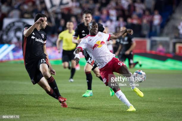 New York Red Bulls Forward Bradley WrightPhillips keeps his concentration to remain in control of the ball against DC United Defender Bobby Boswell...