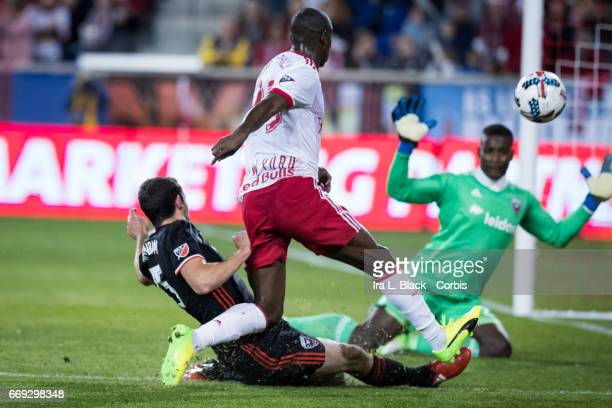 New York Red Bulls Forward Bradley WrightPhillips slips past DC United Defender Steve Birnbaum for the shot on goal during the Soccer MLS New York...