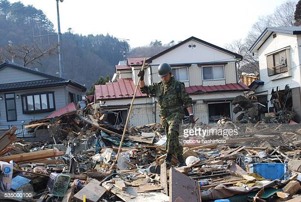 March 152011/Noboru Hashimoto/Tokyo/Japan Mega eartquake disaster in Northern JapanThe selfdefense force soldier search victims in Wataritown in...