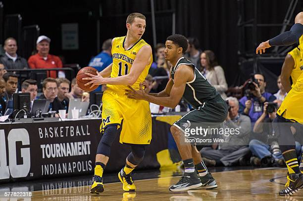 Michigan State Spartans guard Gary Harris defends Michigan Wolverines guard Nik Stauskas during the Big Ten Men's Basketball Tournament Championship...