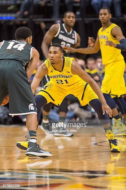 Michigan Wolverines guard Zak Irvin defends Michigan State Spartans guard Gary Harris during the Big Ten Men's Basketball Tournament Championship...