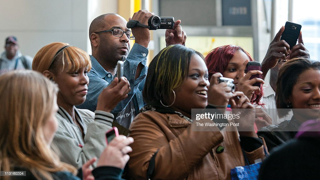 Colin Drummond gathers video footage of RampB singer Chris Brown as he arrives at the Reagan National Airport in Arlington Virginia on March 16...