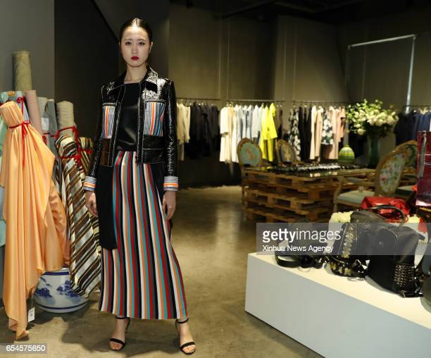 HANGZHOU March 17 2017 A model presents a creation of designer Zhang Yichao at an inauguration ceremony of an incubator of fashion and innovative...