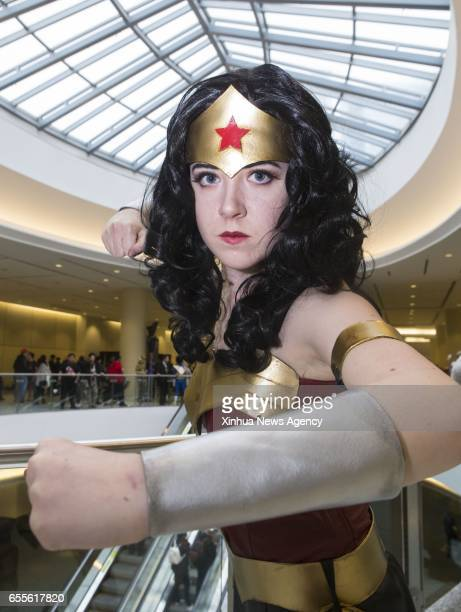 TORONTO March 19 2017 A participant dressed up as Wonder Woman poses for photos during the 2017 Toronto ComiCon in Toronto Canada March 18 2017...