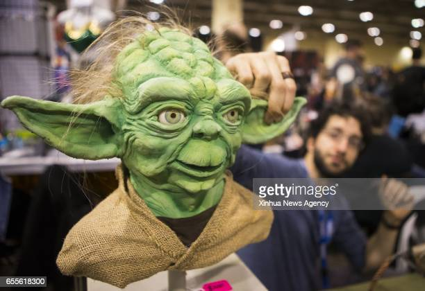 TORONTO March 19 2017 An exhibitor shows a new pattern of Yoda mask during the 2017 Toronto ComiCon in Toronto Canada March 18 2017 Featuring anime...
