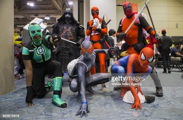 TORONTO March 19 2017 Dressed up participants pose for photos during the 2017 Toronto ComiCon in Toronto Canada March 18 2017 Featuring anime manga...