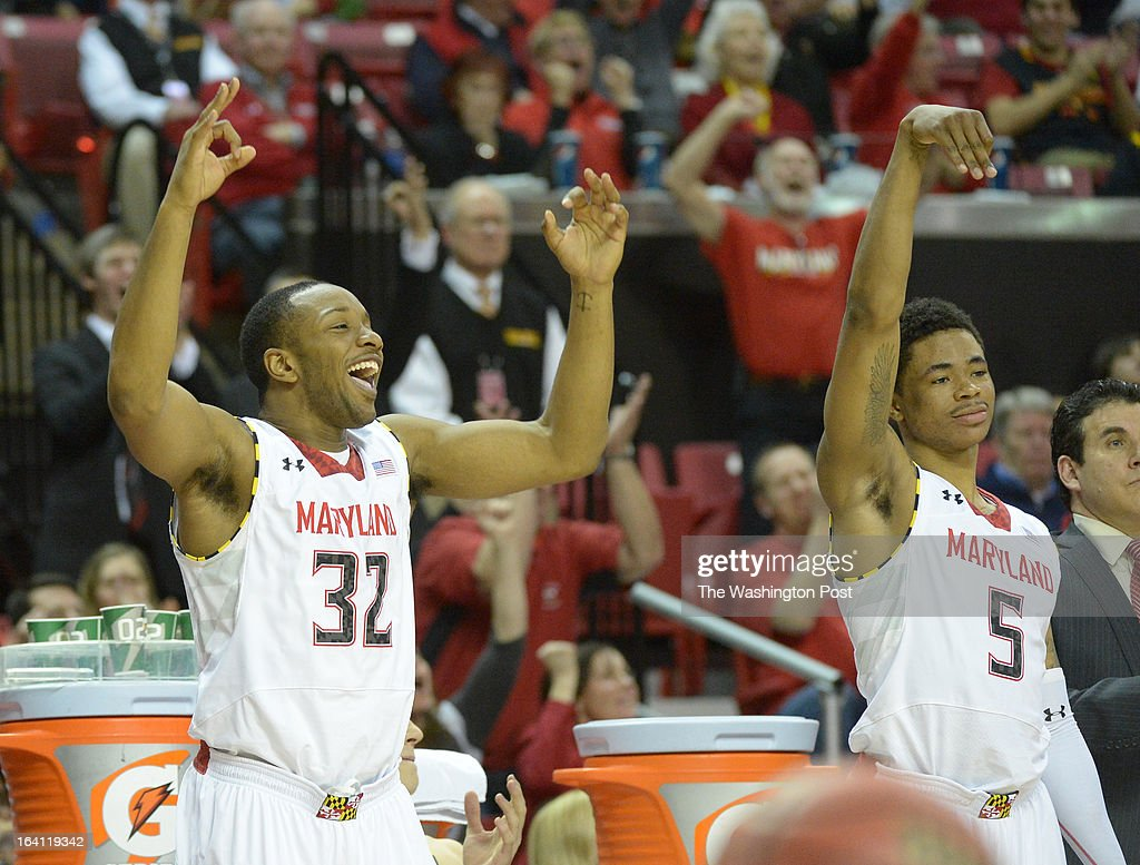 Maryland guards Dez Wells (32) and Nick Faust (5) react after a late three pointer ices their win over Niagara in the first round of the NIT on March 19, 2013 in College Park, MD
