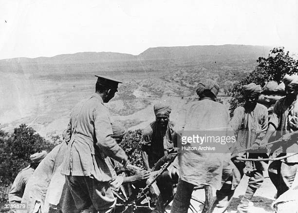 Soldiers haul a mountain gun into postition at Walker Ridge during the Gallipoli Campaign