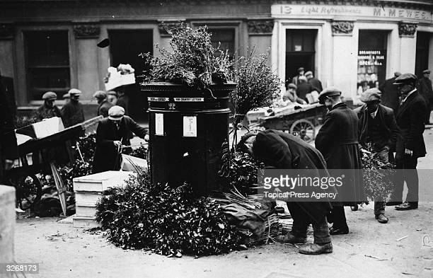 A post box at Covent Garden flower market London is surrounded by flowers as traders prepare their goods for sale